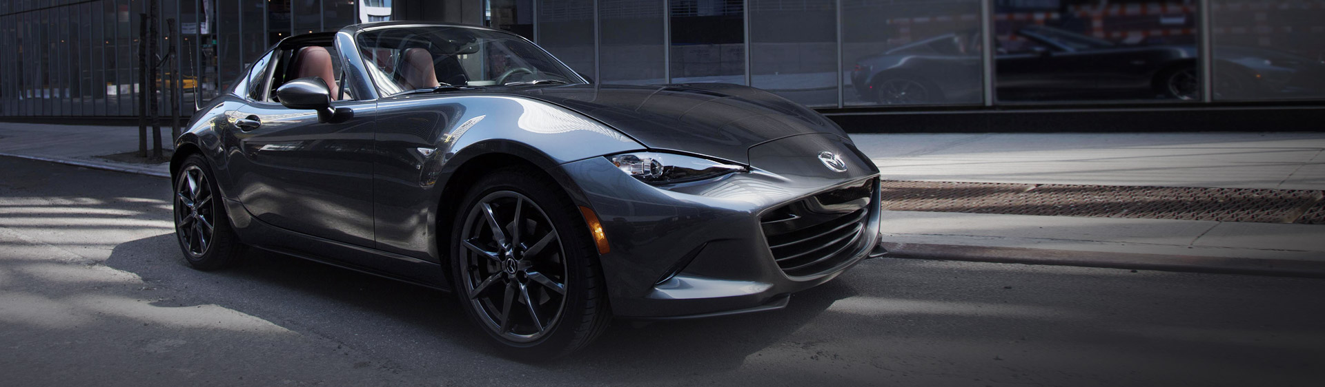 "<div class=""bottom-left""><h1 class=""text-white"">All New MX-5 RF</h1> <p class=""text-white"">Arriving in January 2017 </p> <div class=""button-container""><a href=""/models/new-mx-5-rf/"">Find Out More</a></div></div>"